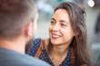 canvas print picture - Lächelnde Frau im Gespräch