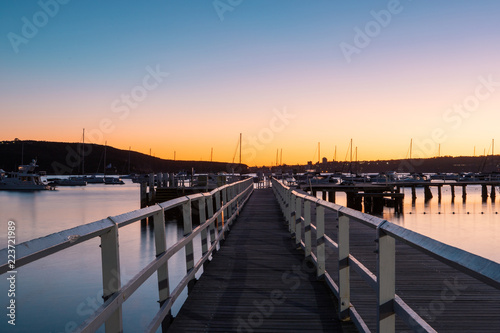 Perspective view of Balmoral Beach pier at dawn. Sydney, Australia.