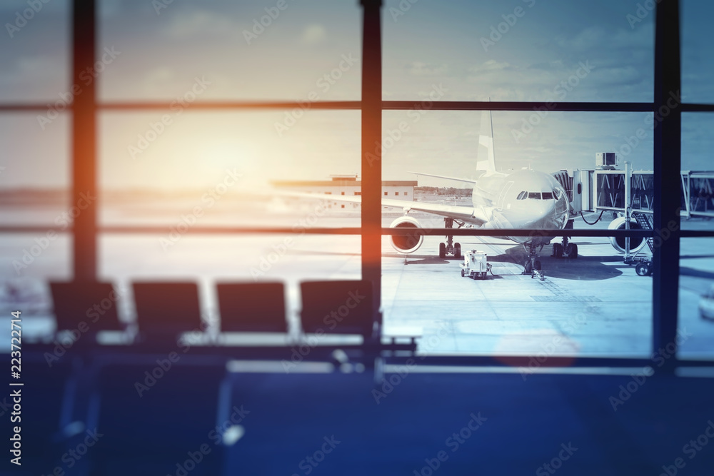 Fototapeta airplane waiting for departure in airport terminal, blurred horizontal background with place for text