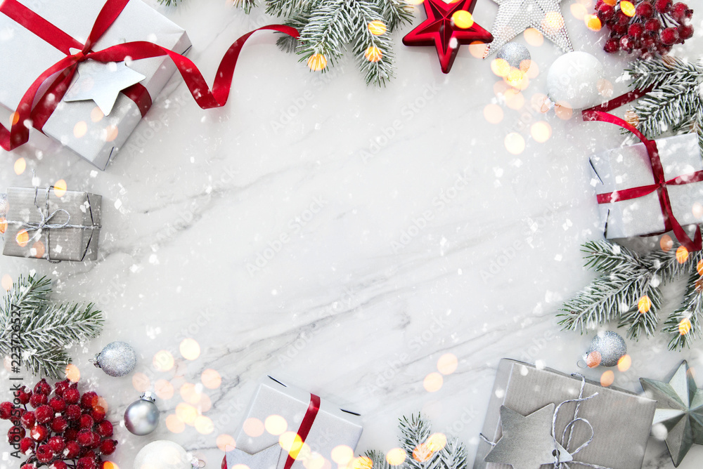 Fototapeta Christmas and New Year holiday background. Xmas greeting card. Christmas gifts on white marble background top view. Flat lay