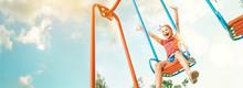 Happy Smiling Cute Little Girl Have Fun When Swing On Swing