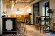 Stylish morden loft interior. Loft bar with wooden chairs