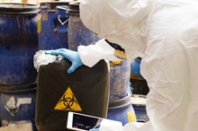 Asian Scientist Wear Chemical Protection Suit Check Danger Chemical,working At Dangerous Zone