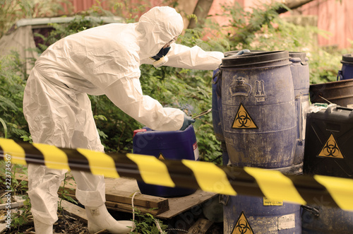 Fototapeta Asian scientist wear Chemical protection suit check danger chemical,working at d