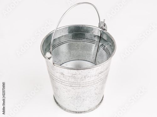 Fotografia  bucket full of water isolated on white