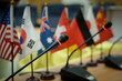 Microphone in a conference room, with flags of various countries