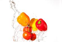 Fresh Vegetables Splashing Through Water