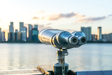 telescope with city skyline