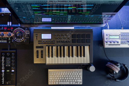 Flat top lay home music studio dj and producer equipment on the black table Wallpaper Mural