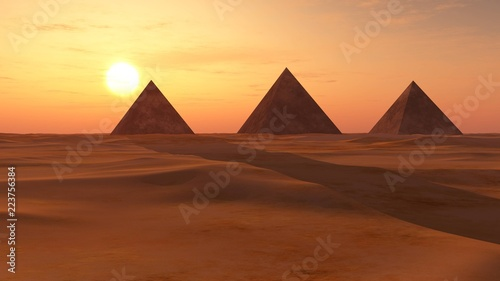 desert of sand with pyramids at sunset.