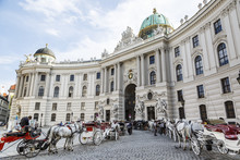 Horse Drawn Carriages In Front Of The Hofburg Palace, Vienna, Austria.
