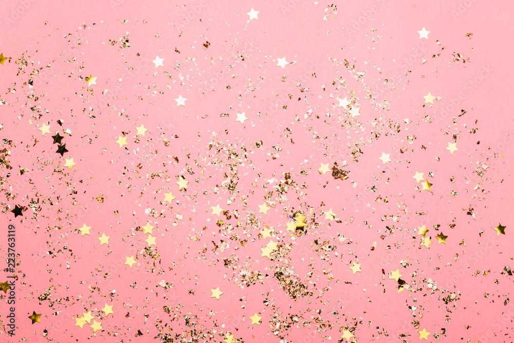 Fototapeta Pink festive confetti background. Bright background for celebration birthday. - obraz na płótnie