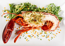 Stuffed Lobster On A Bed Of Gr...