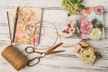 Background With Decorated Gift Boxes, Roll Of Jute And Vintage Scissors