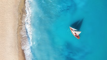 Yacht On The Water Surface Fro...