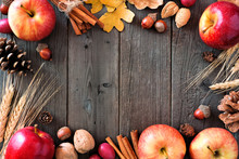 Autumn Frame Of Apples And Fall Ingredients On A Rustic Wood Background With Copy Space