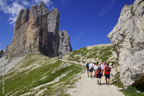 Fotografie, Tablou  Hikers near a pass in the Drei Zinnen area