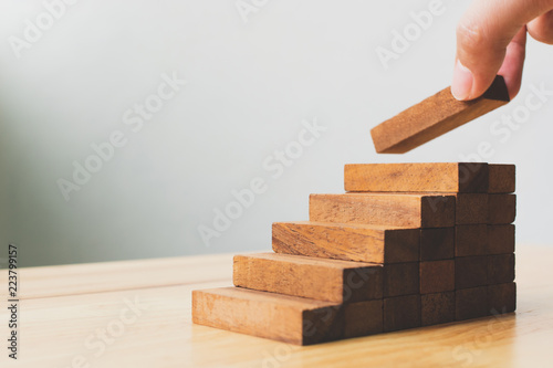 Fotografie, Obraz  Hand arranging wood block stacking as step stair