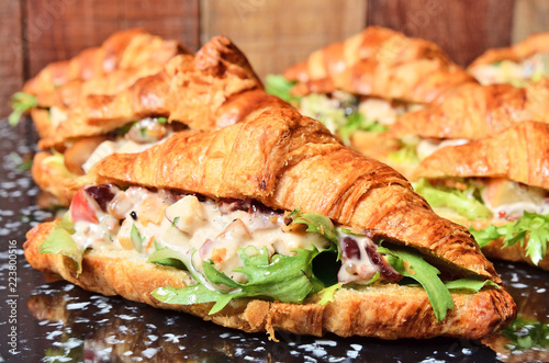 Chicken salad croissant sandwich on buffet table Fototapeta
