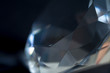 Diamond elements close-up on a black background. Abstraction. Defocused.