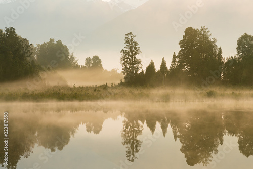 Lake Matheson early morning seen with reflection, New Zealand landscape background