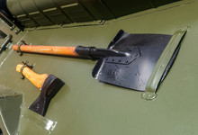 A Shovel And An Axe On A Milit...
