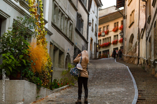 Beautiful girl photographer taking photos in Friburg, Switzerland