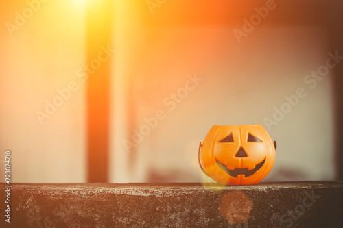 Halloween pumpkin with black eyes dressed on black background Canvas Print