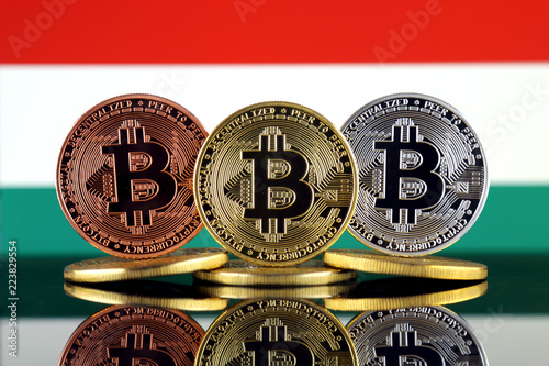 Staande foto Rotterdam Physical version of Bitcoin (BTC) and Hungary Flag. Conceptual image for investors in High Technology (Cryptocurrency, Blockchain Technology, Smart Contracts, ICO).
