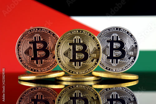 Staande foto Rotterdam Physical version of Bitcoin (BTC) and Jordan Flag. Conceptual image for investors in High Technology (Cryptocurrency, Blockchain Technology, Smart Contracts, ICO).