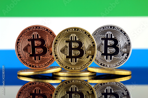 Staande foto Rotterdam Physical version of Bitcoin (BTC) and Sierra Leone Flag. Conceptual image for investors in High Technology (Cryptocurrency, Blockchain Technology, Smart Contracts, ICO).