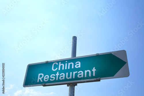 Foto  china restaurant sign, blue sky background
