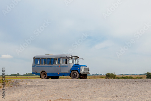 Poster Retro old bus on a countryside road, 1960 year of release