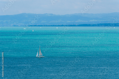 Blue water with many sail boats on german lake