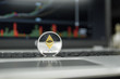 Golden Silver coin of Ethereum on a black keyboard of silver laptop and diagram chart graph on a screen as a background. Virtual cryptocurrency concept. Mining of ethereums online bussiness. Trading.
