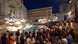 Leinwandbild Motiv Masses of people taking photos of the beautiful Fontana di Trevi at night.