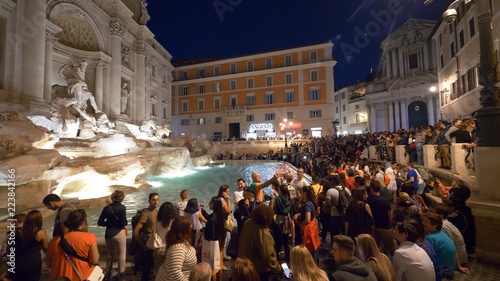 Fotografie, Obraz  Masses of people taking photos of the beautiful Fontana di Trevi at night