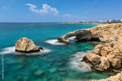 Long exposure shot of Love Bridge - picturesque natural formation creating a white-rock arch in Ayia Napa, Cyprus