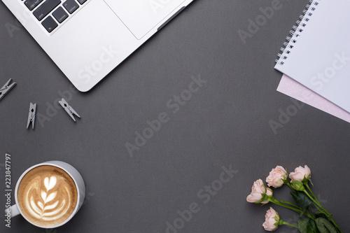 Foto op Plexiglas Retro Empty grey background with coffee,keyboard and flowers in vintage style