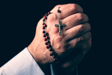 Male Hands Praying Holding A R...