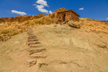 Abandoned Houses Built In The Rock On The Calico Mountains In Calico. Calico Is A Ghost Town And Former Mining In The Mojave Desert Region Of Southern California, United States.
