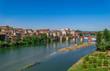 Albi cityscape with Tarn river, medieval bridge and blue sky, Tarn, France
