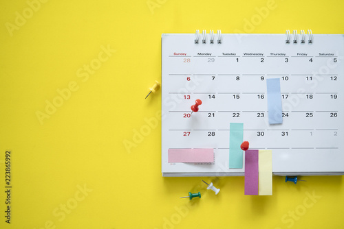 Fototapeta close up of calendar on the yellow background, planning for business meeting or travel planning concept obraz