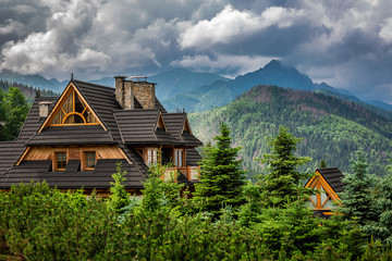 Clouds over Tatra Mountains and wooden cottage, Poland