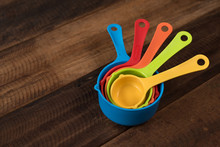 Colorful Measuring Cups On A W...