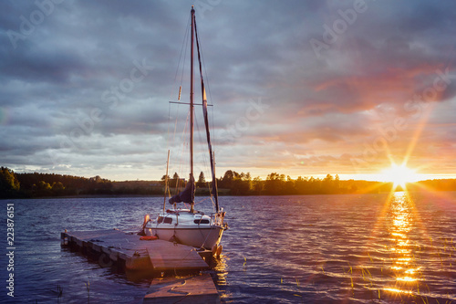Fotografie, Obraz  Yacht at the pier on Lake Ladoga at sunset