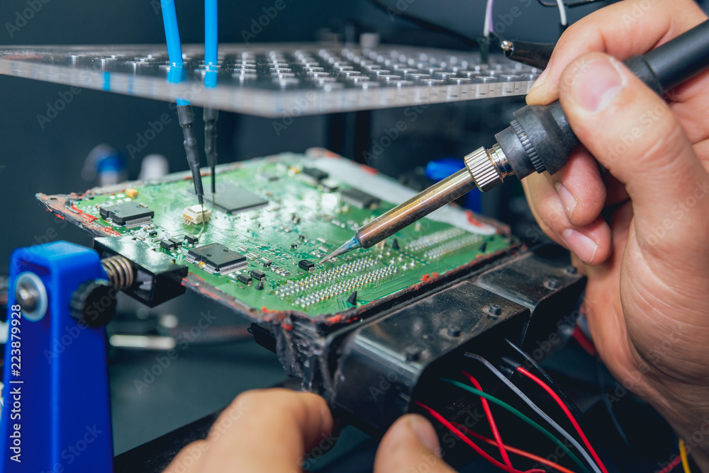 Fototapeta Repair of electronic devices, soldering and circuit board