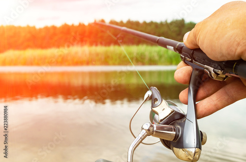 Spinning fishing is an exciting activity. Sport fishing. Copy space.