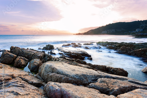 Fényképezés  Long exposure image of Dramatic sky seascape with rock in sunset scenery background