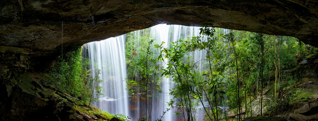 Panoramic beautiful deep forest waterfall in Thailand.